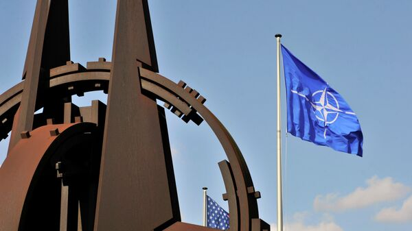 A picture taken on March 2, 2014 shows the NATO flag in the wind at the NATO headquarters in Brussels. - Sputnik International