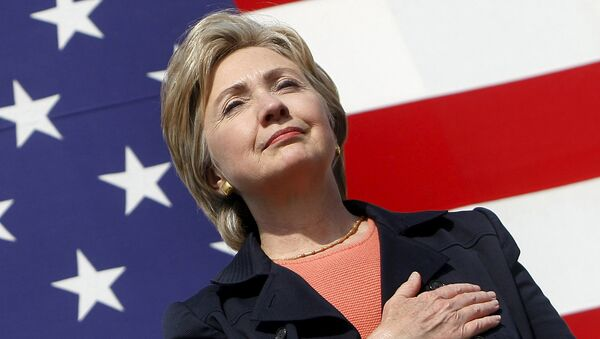 U.S. Senator Hillary Clinton (D-NY) places her hand over her heart during the National Anthem at the 30th annual Harkin Steak Fry in Indianola, Iowa, in this September 16, 2007 file photo - Sputnik International
