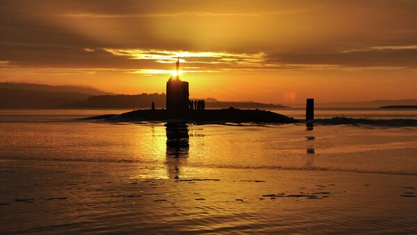 In this image made available by the Ministry of Defence in London, Monday Oct. 18, 2010, the sun rises over the Royal Navy nuclear attack submarine HMS Triumph, as she comes into a naval base on the River Clyde in Scotland, early Sunday Oct. 17, 2010 - Sputnik International