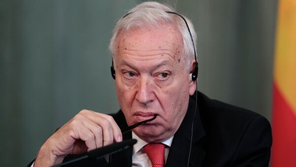 Spanish Foreign Minister Jose Manuel Garcia-Margallo listens to a question during a joint press conference with Russian Foreign Minister Sergey Lavrov in Moscow - Sputnik International