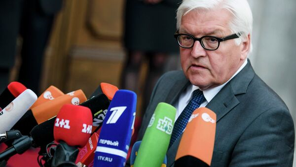 German Foreign Minister Frank-Walter Steinmeier speaks to journalists prior to a meeting of foreign ministers to examine the implementation of the Minsk peace accords - Sputnik International