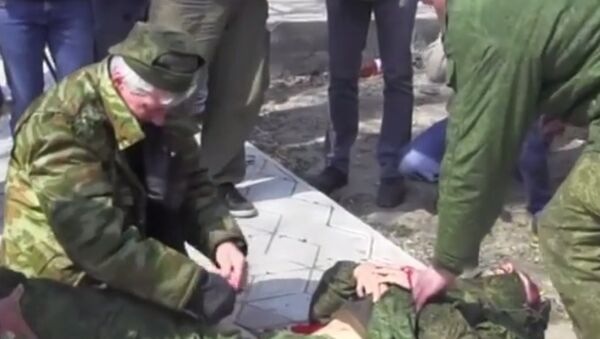 A journalist working for Russian television was seriously injured when he stepped onto a trip-wired booby trap in eastern Ukraine, while covering a ceasefire monitoring mission. - Sputnik International