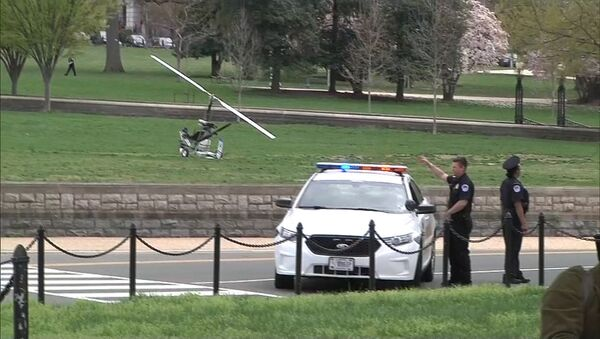 A small helicopter (L) is pictured in this still image taken from video after it landed on the west lawn of the U.S. Capitol in Washington April 15, 2015 - Sputnik International