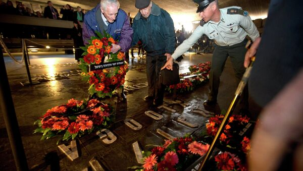 Holocaust survivors and their relatives lay a wreath next to the names of concentration camps during a ceremony marking the annual Holocaust Remembrance Day at the Hall of Remembrance at the Yad Vashem Holocaust memorial, in Jerusalem - Sputnik International
