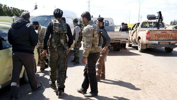 Jabhat al-Nusra militants at the entrance of Idlib city - Sputnik International