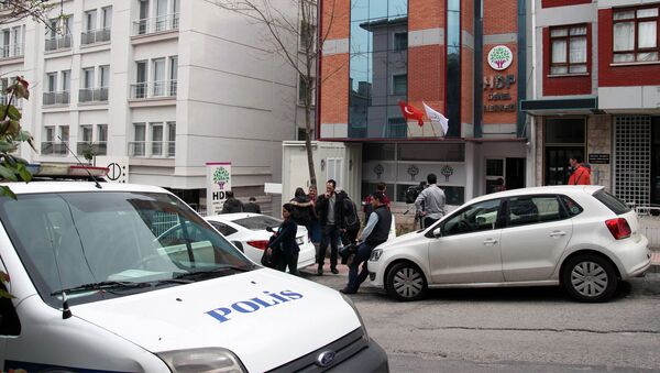 Police are seen outside the headquarters of the pro-Kurdish Peoples' Democratic Party, (HDP) early on April 18, 2015 in Ankara - Sputnik International