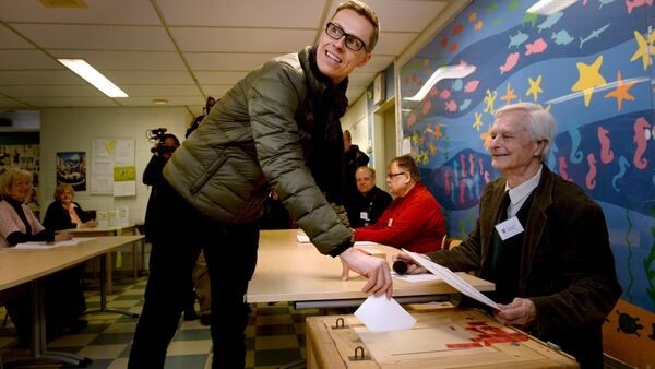 Finnish Prime Minister and leader of National Coalition Party Alexander Stubb casts his vote during the parliamentary election in Espoo, Finland - Sputnik International