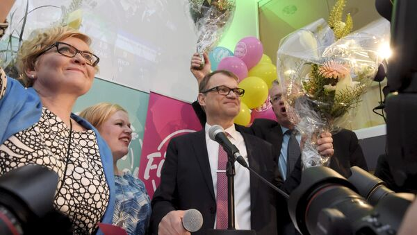 Anu Vehvilainen (L), Annika Saarikko, Chairman Juha Sipila and Juha Rehula of the Centre Party celebrate at the party's parliamentary elections reception in Helsinki after the results of the votes - Sputnik International