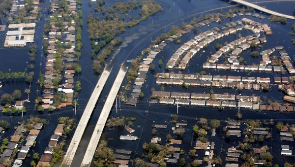 The damage from hurricane Katrina near New Orleans is seen from Air Force One. In 2005 hurricane Katrina, the largest and third strongest hurricane ever recorded to make landfall in the US, left 1,300 people dead. - Sputnik International