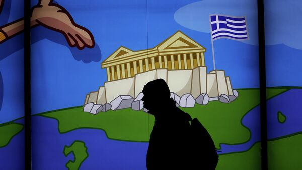 A man walks past a shop with a display window featuring the Acropolis in Athens , on March 14, 2105 - Sputnik International