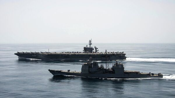 The aircraft carrier USS Theodore Roosevelt (CVN 71) and the guided-missile cruiser USS Normandy (CG 60) operate in the Arabian Sea conducting maritime security operations in this U.S. Navy photo taken April 21, 2015 - Sputnik International