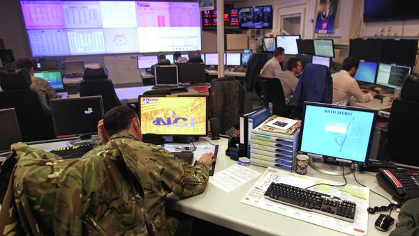 Staff operate at the NATO Computer Incident Response Capability (NCIRC) technical center, at NATO's military headquarters SHAPE in Mons, southwestern Belgium, Tuesday, Dec. 10, 2013. The NCIRC protects NATO systems and information from any form of attack and from deliberate or accidental exposure. - Sputnik International