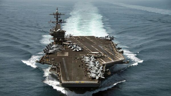 The aircraft carrier USS Theodore Roosevelt (CVN 71) operates in the Arabian Sea conducting maritime security operations in this U.S. Navy photo taken April 21, 2015 - Sputnik International
