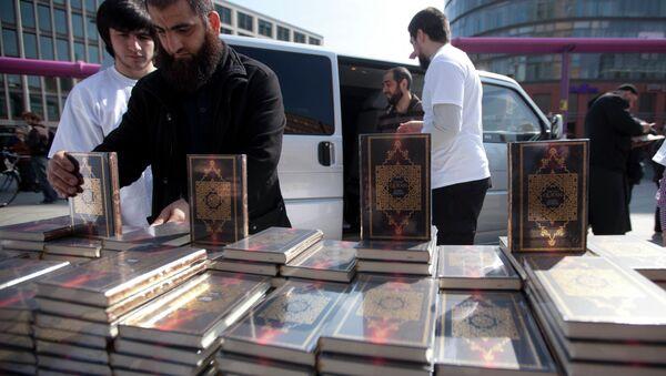 Members of a Muslim group pile Qurans while distributing copies of it at Potsdamer Platz in Berlin, Saturday, April 14, 2012. - Sputnik International