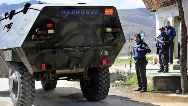 An armoured vehicle of a special police unit passes a checkpoint on the road to the village of Goshince, from where police officers were taken hostage overnight, north of the capital Skopje on April 21, 2015 - Sputnik International