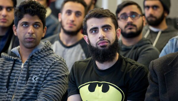 Students at Queens College in New York gather for a vigil, Wednesday, Feb. 18, 2015, in honor of three Muslim students killed recently near the University of North Carolina - Sputnik International