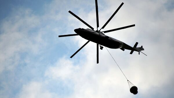 The helicopter of the Ministry of Emergency Situations of the Russian Federation - Sputnik International