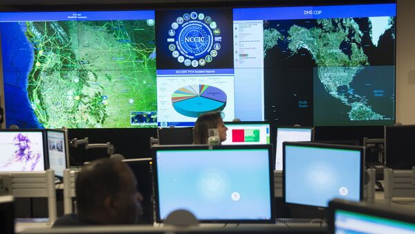 Staff members sit at their work stations at the National Cybersecurity and Communications Integration Center in Arlington, Virginia, January 13, 2015 - Sputnik International