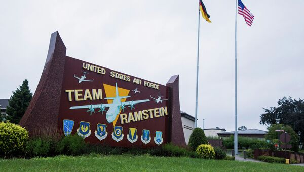 The US and German flags fly behind a sign at Ramstein Air Base, Germany. - Sputnik International