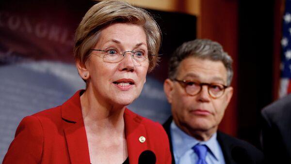 Sen. Elizabeth Warren, D-Mass, left, speaks at a new conference on Capitol Hill in Washington. - Sputnik International