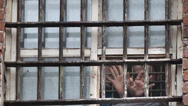 Prisoners in the prison window - Sputnik International