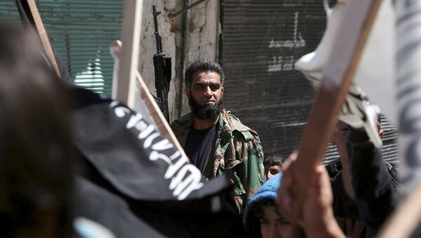 A rebel fighter attends a demonstration celebrating Nusra Front's take over of Idlib about a month ago and calling for the implementation of the Islamic Sharia law, in Al-Sakhour neighborhood of Aleppo - Sputnik International