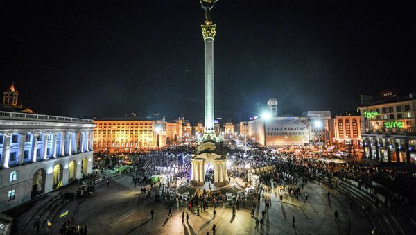 Kiev residents during memorial events on the anniversary of the first protests on Independence Square in Kiev. - Sputnik International