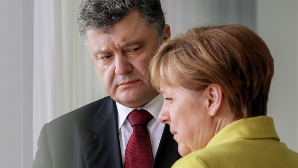 Ukrainian President Petro Poroshenko meets with German Chancellor Angela Merkel - Sputnik International