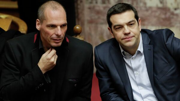 Greece's Prime Minister Alexis Tsipras, right, and Finance Minister Yanis Varoufakis attend a Presidential vote in Athens, on Wednesday, Feb. 18, 2015 - Sputnik International