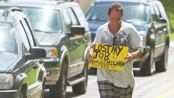 A man tries to collect money for his family on a Miami street corner, two months after losing his job. - Sputnik International