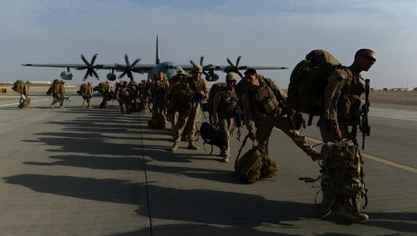 US Marines walk in line after arriving in Kandahar on October 27, 2014, as British and US forces withdraw from the Camp Bastion-Leatherneck complex in Helmand province - Sputnik International