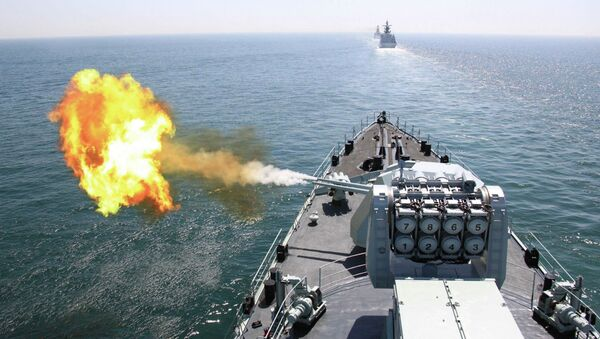 In this April 26, 2012 file photo released by China's Xinhua News Agency, Chinese navy's missile destroyer DDG-112 Harbin fires a shell during the China-Russia joint naval exercise in the Yellow Sea - Sputnik International