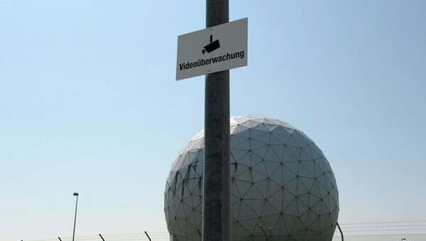 A photo taken on July 16, 2013 shows a sign reading video surveillance fixed to a lamp post in front of radomes of the former monitoring base of the US intelligence organization National Security Agency (NSA) in Bad Aibling, southern Germany - Sputnik International