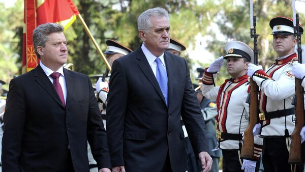 Serbia's President Tomislav Nikolic, center, is welcomed by his Macedonian counterpart Gjorge Ivanov, left, upon his arrival at Macedonia's capital Skopje, on Friday, Oct. 26, 2012 - Sputnik International