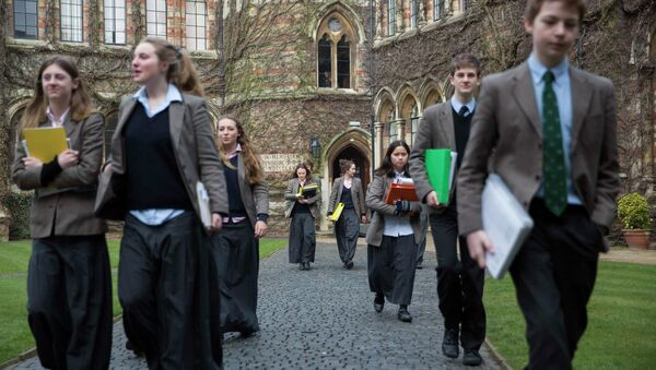 Pupils walk to lessons at Rugby School in central England, March 18, 2015 - Sputnik International