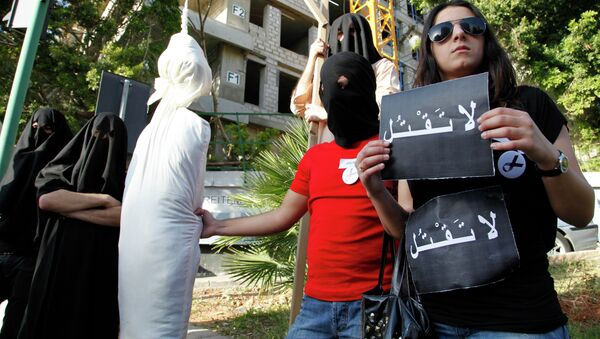 In this 2010 file photo, activists from a civil organization reenact an execution scene in front of the Saudi Arabia Embassy in Beirut, Lebanon, as they protest the beheading of a Lebanese man accused of witchcraft in Saudi Arabia. - Sputnik International