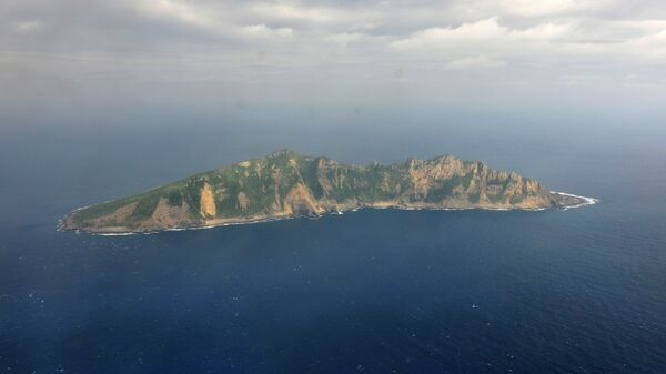 One of the small islands in the East China Sea known as Senkaku in Japanese and Diaoyu in Chinese is seen from a Chinese marine surveillance plane - Sputnik International