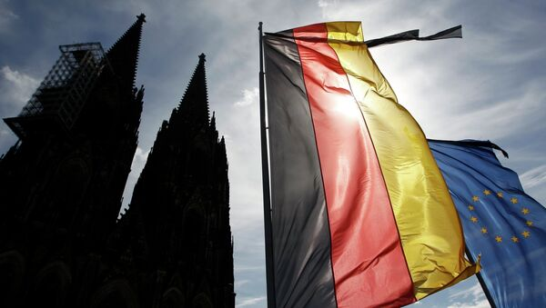 Flags of Germany and the EU fly with black ribbons during a memorial service for the 150 victims of Germanwings flight 4U 9525 in Cologne's Cathedral, April 17, 2015 - Sputnik International