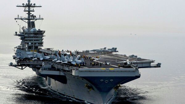 The aircraft carrier USS Theodore Roosevelt (CVN 71) sails in the Arabian Sea, in this U.S. Navy  - Sputnik International