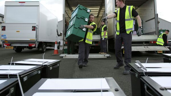 City council workers assemble ballot boxes for distribution ahead of tomorrow's general election, in Glasgow, Scotland, Britain, May 6, 2015 - Sputnik International