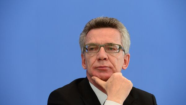 German Interior Minister Thomas de Maiziere attends a press conference to present politically-motivated crime rate in Germany - Sputnik International