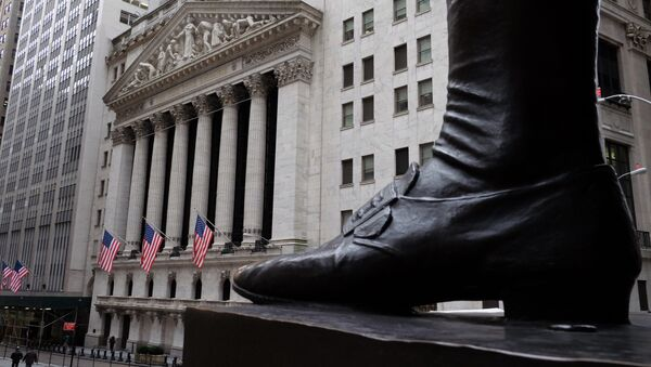 People walk past the New York Stock Exchange (NYSE) on the Wall Street in New York - Sputnik International