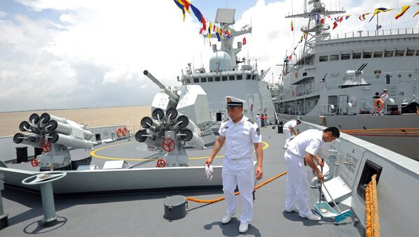 Crew members work on the Chinese Navy ship Wei Fang as it docks at the Myanmar International Terminal Thilawa (MITT) port on the outskirts of Yangon on May 23, 2014 - Sputnik International