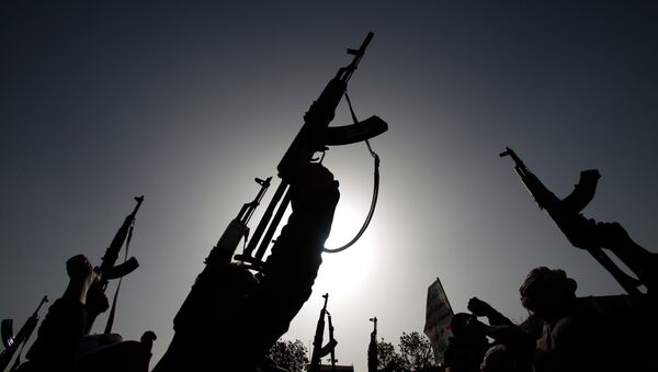 Shiite rebels known as Houthis hold up their weapons to denounce the Saudi-led airstrikes as they chant slogans during a protest in Sanaa, Yemen - Sputnik International