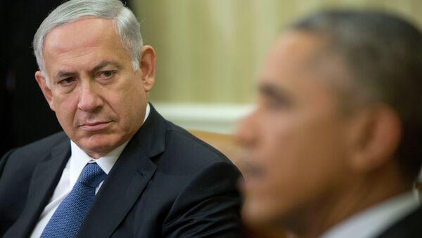 Israeli Prime Minister Benjamin Netanyahu listens as President Barack Obama speaks during their meeting in the Oval Office of the White House in Washington, Wednesday, Oct. 1, 2014. - Sputnik International