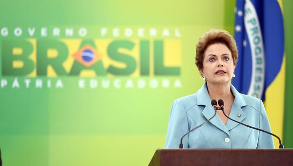 Brazilian President Dilma Rousseff delivers a speech on May 8, 2015, during a ceremony at the Planalto Palace in Brasilia to mark the 70th anniversary of the victory over Nazi Germany during World War II - Sputnik International