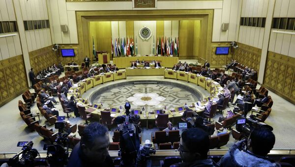 Representatives of the Arab League attend an emergency meeting to discuss the conflict in Libya, at the Arab League headquarters in Cairo, Egypt, Monday, Jan. 5, 2015. - Sputnik International
