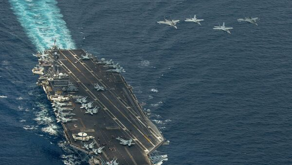 Two F/A-18 Super Hornets and two Royal Malaysian Air Force Mig 29 Fulcrum fly in formation above aircraft carrier USS Carl Vinson - Sputnik International
