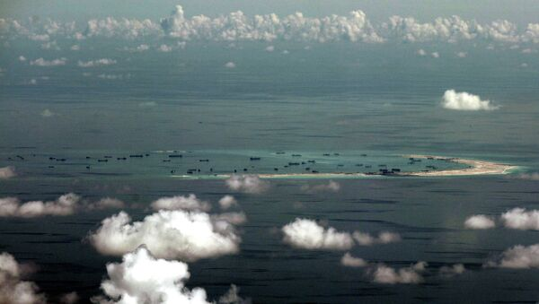 China's alleged on-going reclamation of Mischief Reef in the Spratly Islands. - Sputnik International