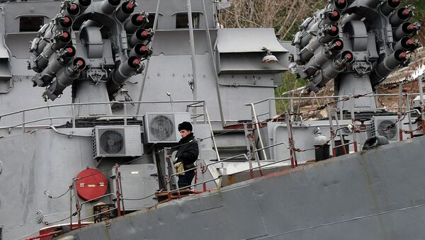 A Russian soldier stands on the Russian Black Sea Fleet Small Antisubmarine Warfare ship (ASW) Alexandrovets in the port of Sevastopol - Sputnik International